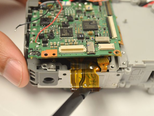 Be careful not to rip the ribbon cable out from the ZIF connector the ribbon cable is attached to.