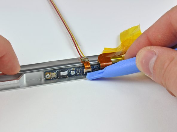 Slide the iSight cable out of its socket.