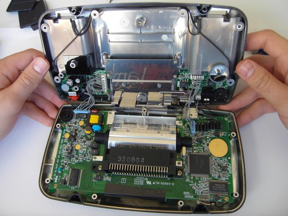 Do not pull the back of the case away, as cables are connected between both sides.