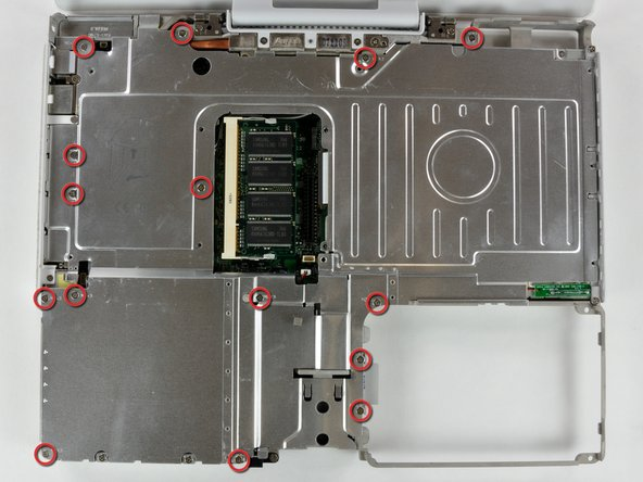 Image 1/1: Remove the fifteen 3 mm Phillips screws securing the top shield to the computer.