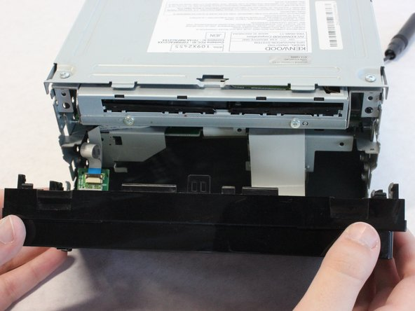 Pull the top of the front panel out and down to remove front panel.