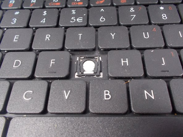 On the keyboard, locate the position of the missing key.