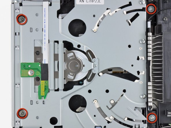 Remove the four 9 mm Phillips screws securing the DVD drive to the bottom panel.