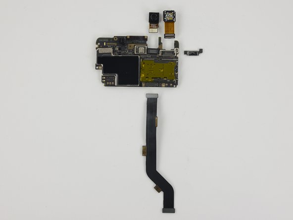 Once the motherboard is removed the following components can be removed: camera bracket, cameras, interconnect cable.