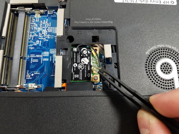 Carefully remove gold-headed, black wires from Wi-Fi card with tweezers.