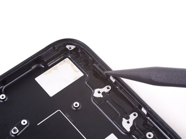 Repeat the procedure to push the right rubber speaker vent out of the rear case.