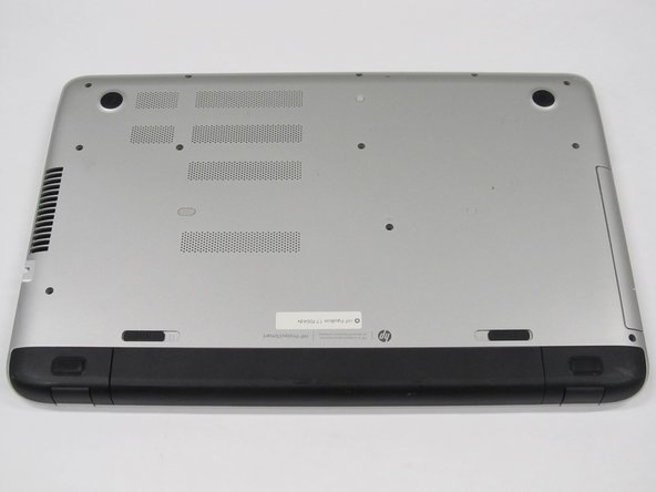Image 1/1: Rotate the laptop so the back panel is facing up.