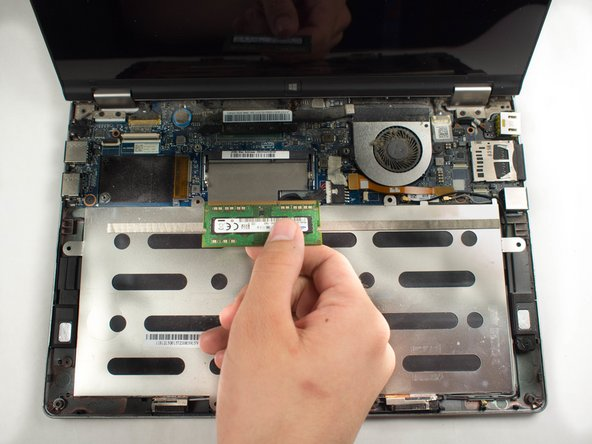 Grab the RAM module and carefully pull it out from its position.