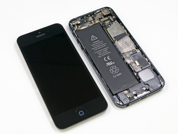 Image 2/2: Never fear, our faithful iPhone delivers; we'll be sure to take a closer look at each of these components as we remove them.