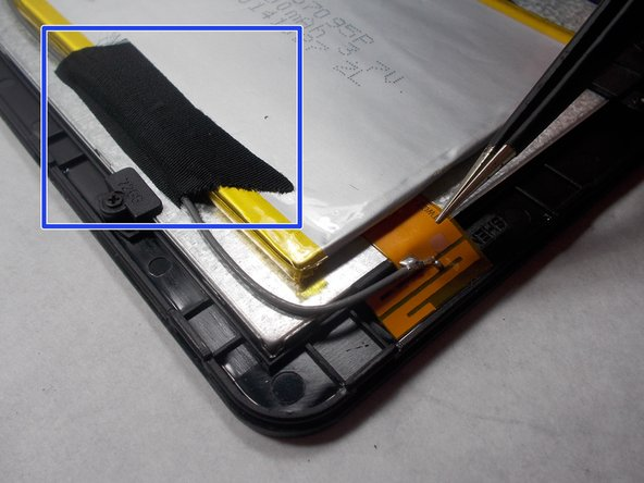 Image 1/1: Strip of tape will be over both the antenna, and the edge of the battery
