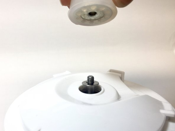 Whilst holding the fan on the inside, unscrew the silicon grip on the top of the blender. This should unscrew with a small amount of force.