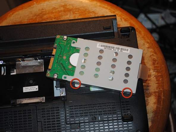 Remove hard drive from computer and loosen 4 screws that hold it into it's metal housing.