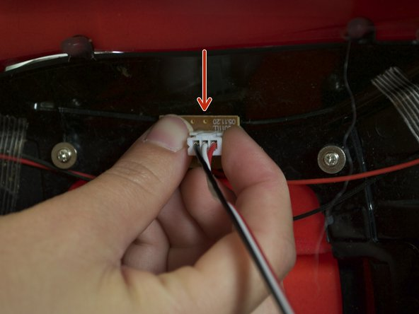 Put the car back together.   Plug the light connector back into its correct position. Put electrical tape back on the wire you took off in step two. Follow the prerequisite steps in reverse order to fully put your car back together.