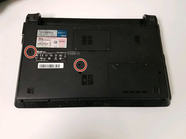 Use the Phillips #0 screwdriver to remove the two screws on the back of the laptop.