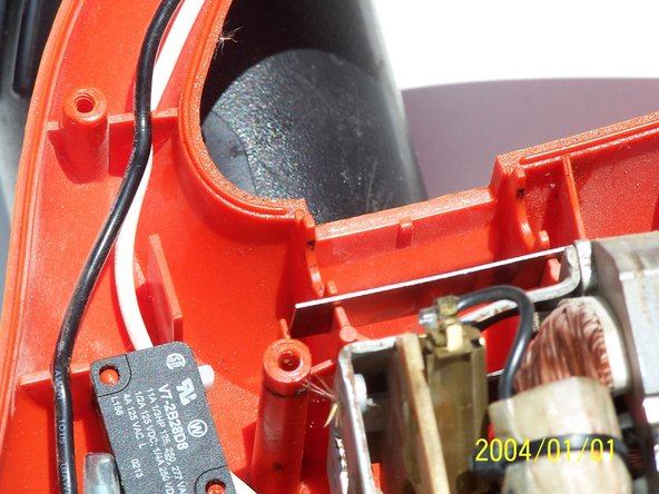 Image 1/3: Remove the tension plate (the metal piece).
