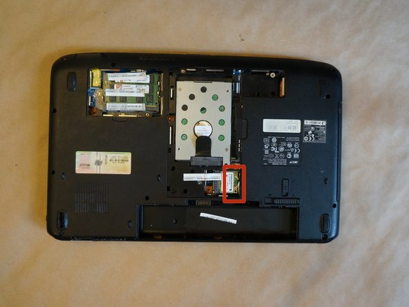 Image 3/3: At the bottom of laptop unplug two coax cables which pierce top case and mother board