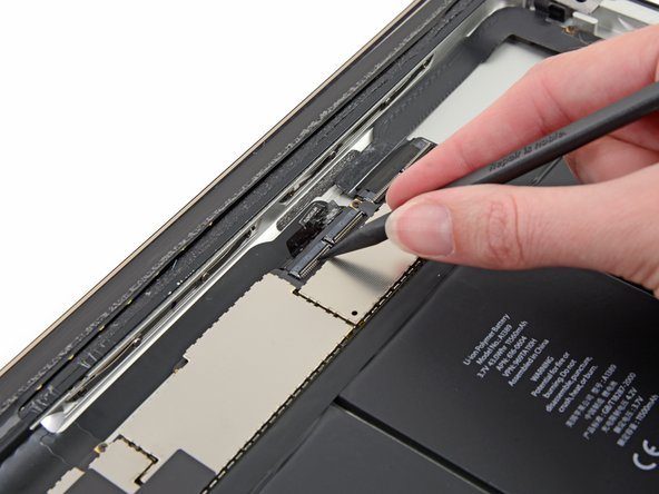 Flip up the retaining flap on both of the digitizer ribbon cable ZIF connectors.