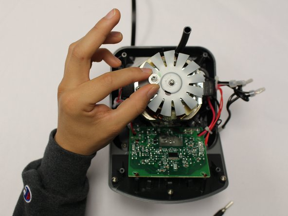 Remove washer then slide the fan off the screw.