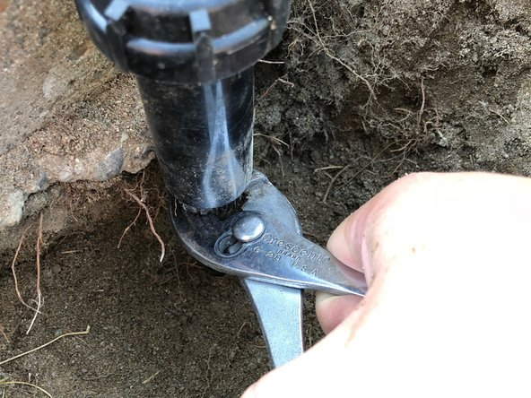 Unscrew the sprinkler head from the line it is attached to.