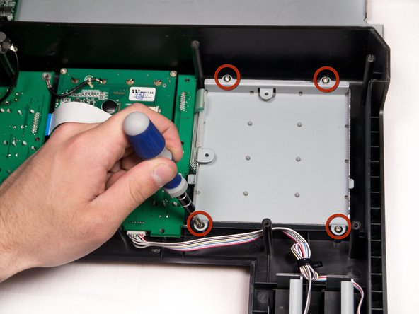 Using a Phillips #2 screwdriver, remove the four 9.8mm screws holding in the base of the beat pad.