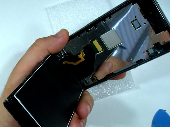 Disconnect the display assemble flex cable.