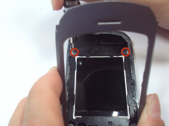 Use one hand to grasp the phone and prop the inner grey casing up.