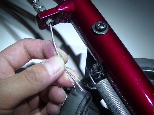 Thread the cable wire through the unfastened brake loop and nut.