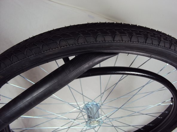 Before replacing the tube, feel along the tire to check for and remove any objects stuck in the tire.