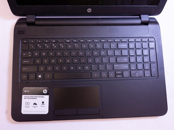 Begin by opening the laptop to expose the keyboard.
