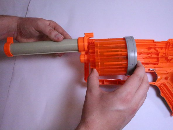 With your hands gently grasp the barrel and chamber of the gun, and pull it away from the main body.