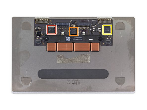 With the strain gauge bracket removed, we take a closer look at the chips powering this newfangled trackpad: