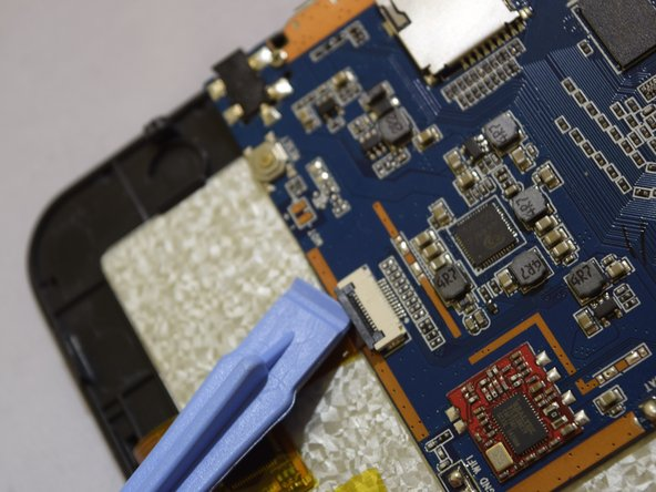 Remove the second electrical ribbon from the motherboard.