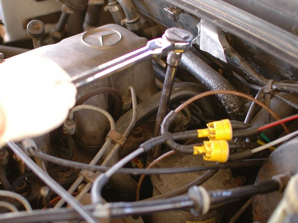 Next, loosen the two nuts that hold the lid on the oil filter housing. They take a 13mm socket just like the drain plug.