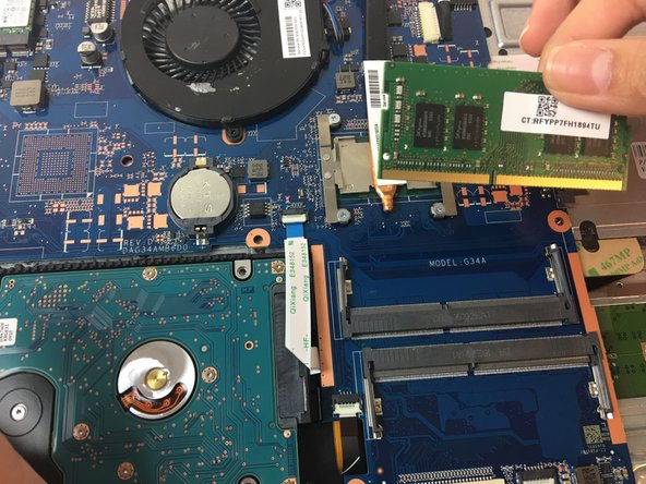 Pull the RAM stick out of the motherboard.