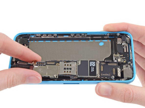 Image 1/2: Do not try to remove the logic board from the rear case yet, as it is still connected by an antenna cable on the back.
