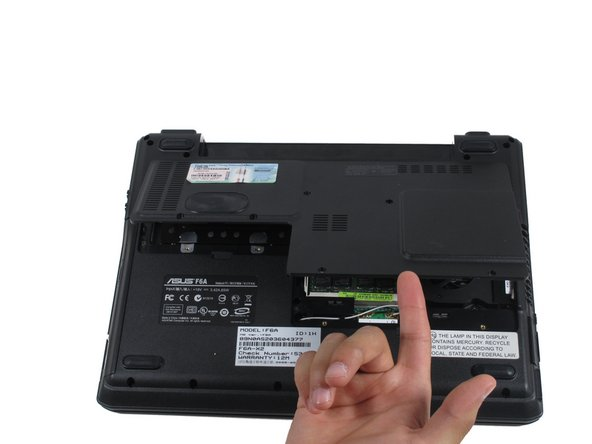Gently lift the upwards, and the back panel of the laptop will come off easily.