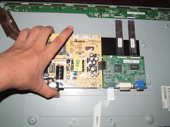 Only lift the power supply up at a slight angle. Lifting it up too much can damage the power supply and potentially the video processing board.