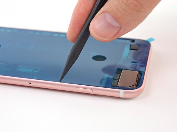 Use the tip of a spudger to gently press all the adhesive into place around the entire perimeter of your iPhone.