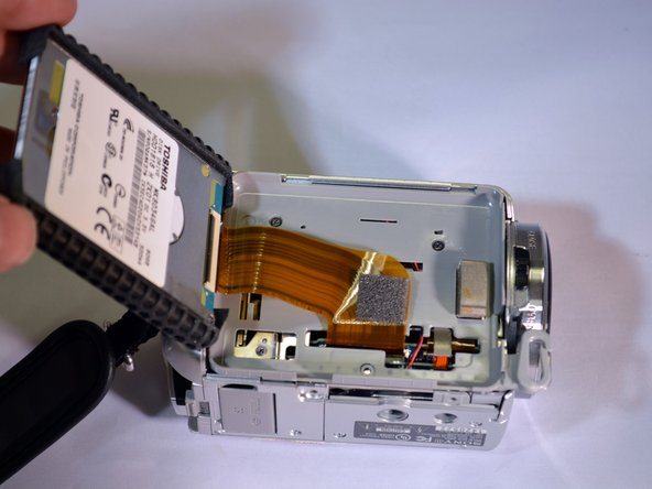Image 3/3: The HDD ribbon wire is now exposed.