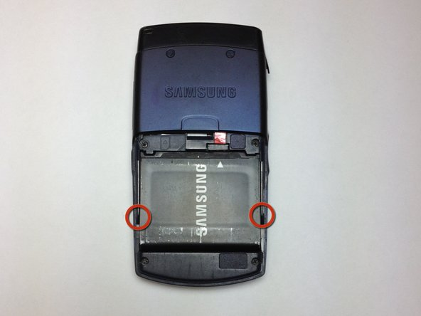 Use your fingers to pull the battery out of its position. You may also flip the phone and the battery will fall out.