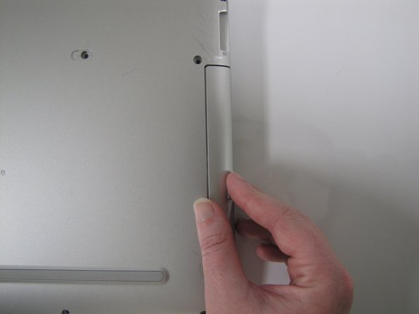 On the right-hand corner of the laptop, remove the CD-ROM by pressing the small button on the side. Pull it out of the laptop, and set it to the side.
