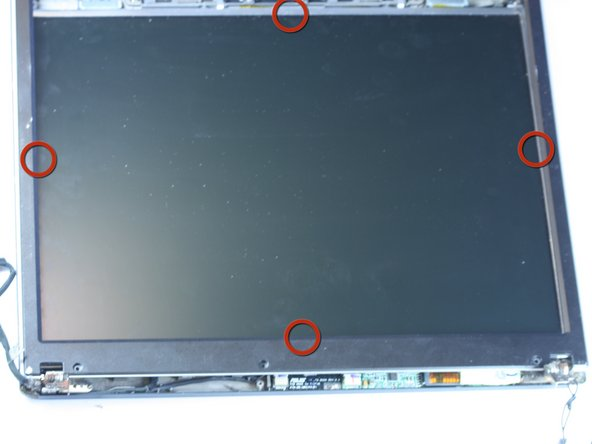 Using a finger or plastic opening tool, gently pry the bezel up from the screen.