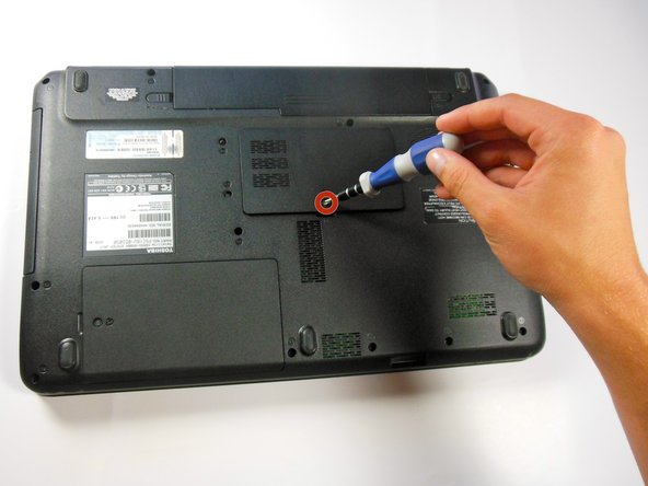 """Image 1/2: Remove the 5.5 mm """"F5"""" screw with the Phillips #1 screwdriver and lift off plastic cover."""
