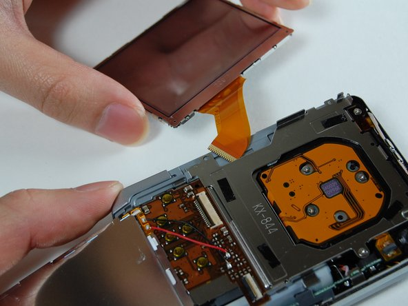 Image 3/3: Pull out the LCD screen with the ribbon from the camera.
