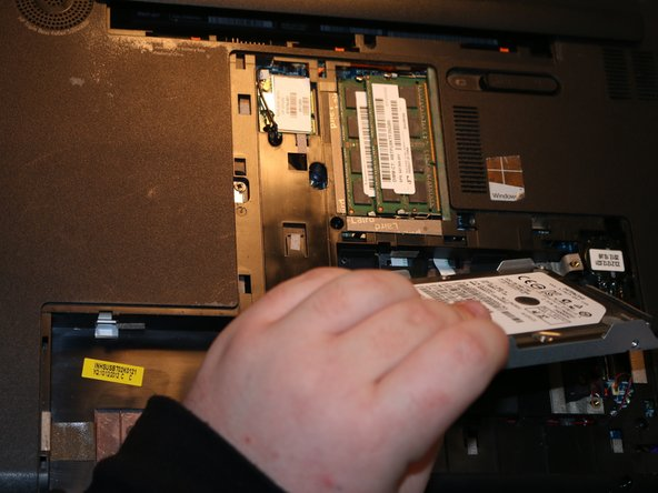 To gain access to the actual hard drive, there are two screws located on either long side of the casing that need to be undone.  These screws are 3mm long and require a Phillips #1 Screwdriver to undo.