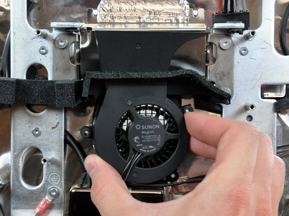 Pull the hard drive fan away from the rear case.