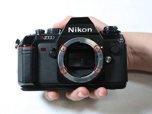 Nikon N2000 Austausch des Objektiveinfassung (Objektivbajonett)