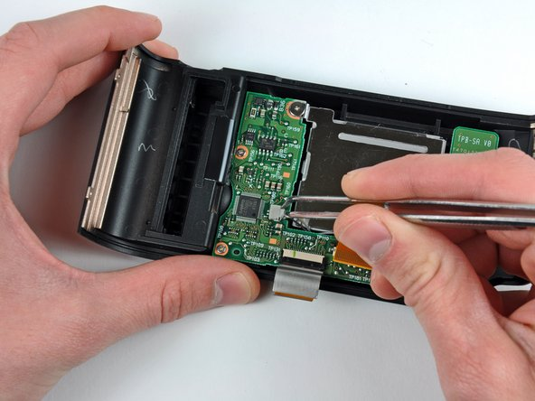 Use a pair of tweezers to pull the LCD backlight connector away from its socket.