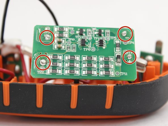 Locate the four soldering joints (two connected to battery contact board and two connected trigger/switch board).