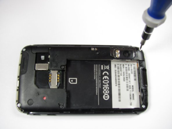 Image 2/3: Lift up the black rubber flap near the SD card slot.